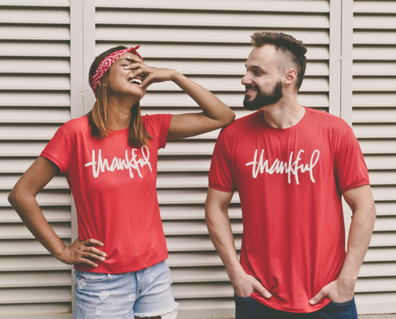 couple wearing red thankful t-shirts