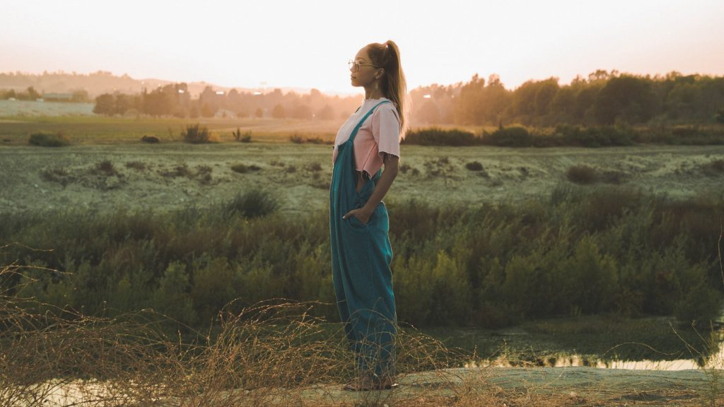multicultural romance novels | Lumiana by Alex Benkast | woman standing on a meadow