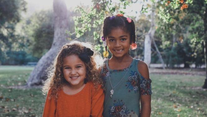 Two smiling girls in garden
